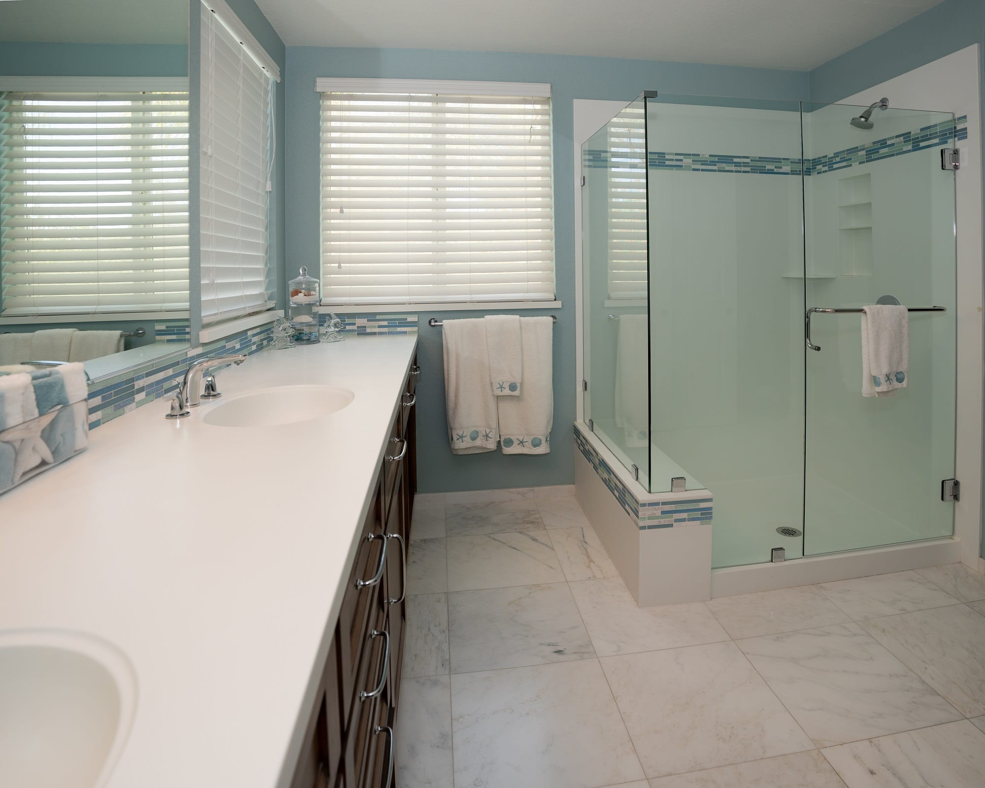 Photo of bathroom with Signature Surfaces shower and countertops